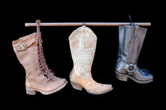 Cowboy boots isolated on a black background Stock Photos
