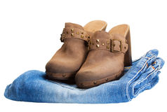 Cowboy boots in jeans. Isolated over white stock image