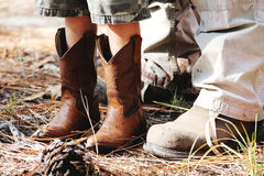 Cowboy boots kid work boots man Royalty Free Stock Image