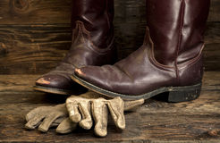 Cowboy boots and leather gloves. Stock Images