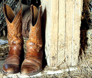 Cowboy Boots. An old pair of cowboy boots in the barn stock photography