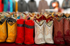Cowboy boots. Pink and yellow cowboy boots for children royalty free stock photography