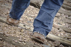 Cowboy Boots and Railroad Tracks Royalty Free Stock Photography
