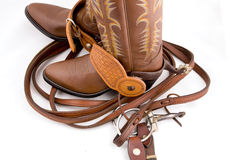 Cowboy boots and reins. Brown leather cowboy boots and reins on a white background Royalty Free Stock Photo