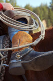 Cowboy Boots and Ropes. Close up of a cowboy's boots and rope while on his horse stock photo