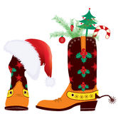 Cowboy boots and Santa's red hat for design Stock Photos