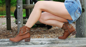 Cowboy boots on sexy legs Royalty Free Stock Photo