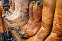 Cowboy boots on a shelf in a store aligned, closeup royalty free stock photo