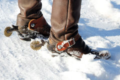 Cowboy Boots in the Snow. A cowboy in the snow. This image shows the detail of his boots and spurs royalty free stock photos