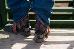 Cowboy boots with spurs. And blue jeans stock images