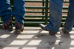 Cowboy boots with spurs. And blue jeans stock photo