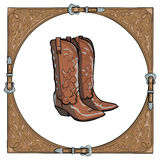 Cowboy boots in the western leather frame on white background. Royalty Free Stock Image