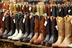 Cowboy Boots in Western Store. Great selection of cowboy boots in retail space stock photos