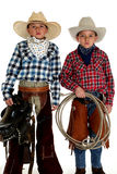 Cowboy brothers wearing hats holding saddle and rope Stock Image