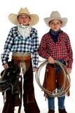 Cowboy brothers wearing hats holding saddle and rope. Cowboys wearing hats holding saddle and rope stock image