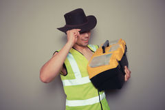 Cowboy builder with tool box. A cowboy builder with a big tool box is pulling silly faces and gesturing royalty free stock images