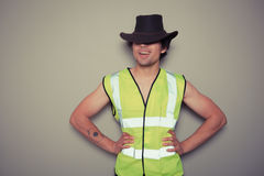 Cowboy builder wearing a high visibility vest Stock Photography