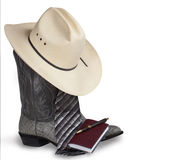Cowboy Business. The necessities of a cowboy businessman -- Cowboy hat and boots, tie, nice writing pen and notebook. On white background with copy space royalty free stock image