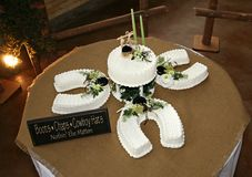 Cowboy Cake. Western cowboy wedding cake in shape of horseshoes Royalty Free Stock Images