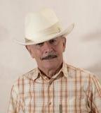 Cowboy in cappello bianco Fotografia Stock