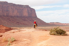 Cowboy caught in sun on rock bluff in Monument Valley Utah USA Stock Photos