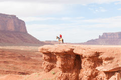 Cowboy caught in sun on rock bluff in Monument Valley Utah USA Royalty Free Stock Images