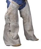 Cowboy in Chaps and Boots. Isolated on a white background Royalty Free Stock Photography