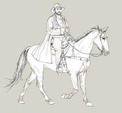 Cowboy che monta un cavallo Immagini Stock