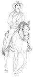 Cowboy che monta un cavallo Fotografia Stock Libera da Diritti