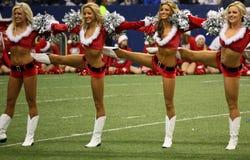Cowboy-Cheerleader-Weihnachtshalbzeitzeile Lizenzfreie Stockfotografie