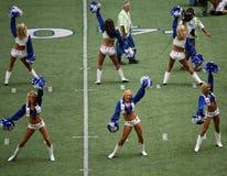 Cowboy-Cheerleadern und Kamera-Männer Stockbild