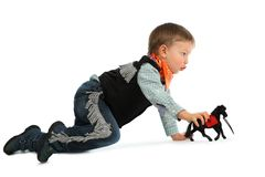 Cowboy child. With black horse toy Stock Images