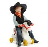 Cowboy child. Riding white horse Stock Photo
