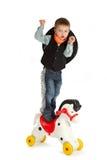 Cowboy child. Riding white horse Stock Photos