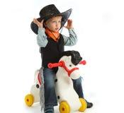 Cowboy child. Riding white horse Royalty Free Stock Photo