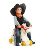 Cowboy child. Riding white horse Royalty Free Stock Image