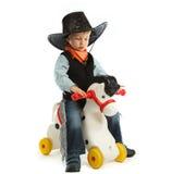 Cowboy child. Riding white horse Stock Image