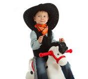 Cowboy child. Riding white horse Royalty Free Stock Photography