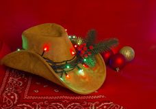 Cowboy Christmas.American West hat and bandanna on christmas red stock images