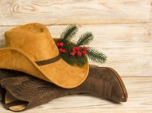 Cowboy Christmas.American West traditional boots and hat on wood. Background texture stock photos