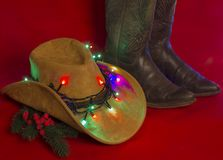 Cowboy Christmas.American West traditional boots on christmas re royalty free stock image