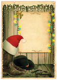 Cowboy Christmas background with Santa hat and antique paper for Stock Photography