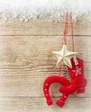Cowboy christmas background with western toy boot and star on wo Royalty Free Stock Photography