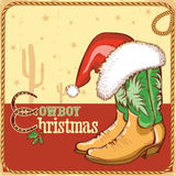Cowboy christmas card with american boots and Sant Royalty Free Stock Photos