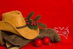 Cowboy Christmas card.American West traditional boots and hat on stock photography