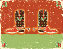 Cowboy christmas card with boots Royalty Free Stock Image