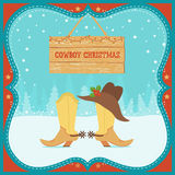 Cowboy Christmas card with western boots and hat on winter backg Stock Images