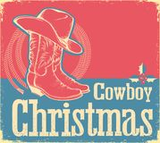 Cowboy Christmas card with western shoes and hat Stock Photo