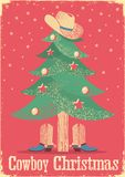 Cowboy Christmas card with tree and western clothes. Stock Image