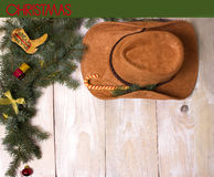 Cowboy christmas on wood background for design Stock Photos